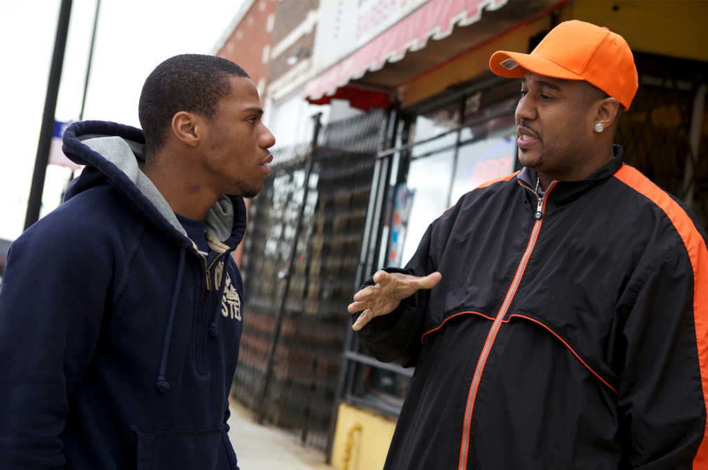 A violence interrupter offering advice to a young Chicago resident